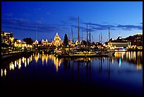 Boats in inner harbour and parliament buildings lights. Victoria, British Columbia, Canada