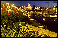 Flowers, inner harbour, and lights at night. Victoria, British Columbia, Canada (color)