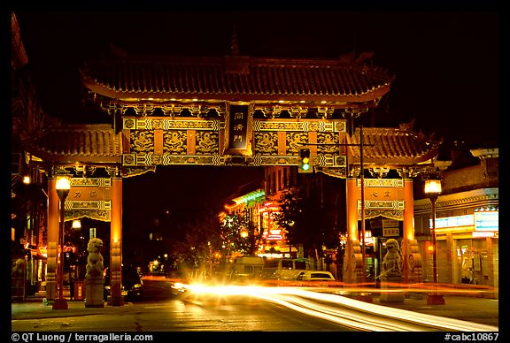 Chinatown gate with trail of lights at night. Victoria, British Columbia, Canada