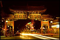 Chinatown gate with trail of lights at night. Victoria, British Columbia, Canada (color)