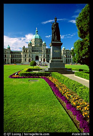 Lawn, statue of Queen Victoria for whom the city was named, and parliament. Victoria, British Columbia, Canada (color)