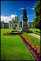 Lawn, statue of Queen Victoria for whom the city was named, and parliament. Victoria, British Columbia, Canada