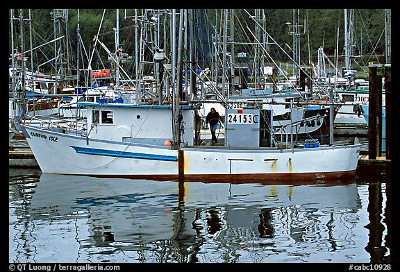 Fishing boat and reflections in harbor, Uclulet. Vancouver Island, British Columbia, Canada (color)