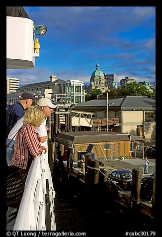 Passengers standing on the deck of the ferry, as it sails into the Inner Harbor. Victoria, British Columbia, Canada