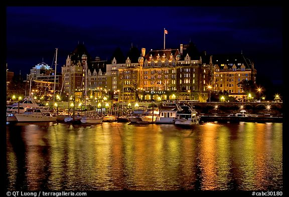 Empress hotel reflected in the Inner Harbour a night. Victoria, British Columbia, Canada