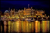 Empress hotel reflected in the Inner Harbour a night. Victoria, British Columbia, Canada (color)