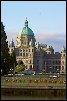 Legistlative buildings and Victoria written in flowers, morning. Victoria, British Columbia, Canada (color)