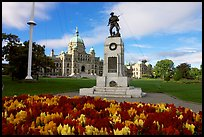Flowers, memorial, and parliament building. Victoria, British Columbia, Canada (color)