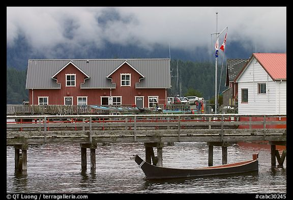 Pier and waterfront buildings, Tofino. Vancouver Island, British Columbia, Canada (color)