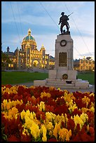 Flowers, memorial, and illuminated parliament. Victoria, British Columbia, Canada (color)