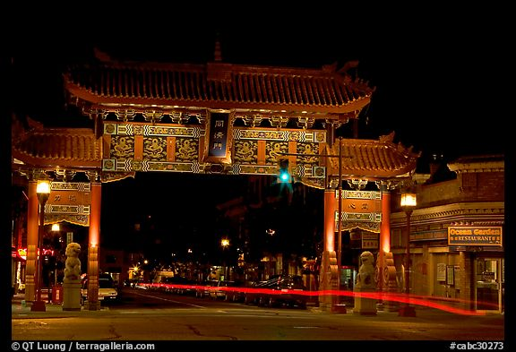 Gate of Harmonious Interest marking the entrance of Chinatown, night. Victoria, British Columbia, Canada (color)