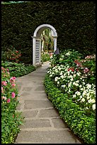 Arched entrance  leading to the Italian Garden. Butchart Gardens, Victoria, British Columbia, Canada