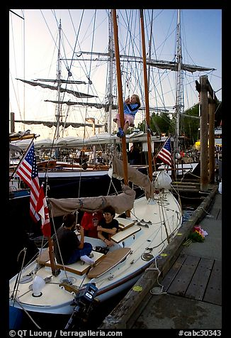 Kids in a small sailboat docked in Inner Habor. Victoria, British Columbia, Canada (color)