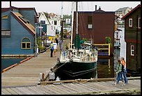Houseboats, deck, and sailboat, Upper Harbour. Victoria, British Columbia, Canada (color)