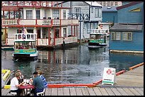 Harbor ferries and outdoor eatery, Upper Harbor. Victoria, British Columbia, Canada (color)