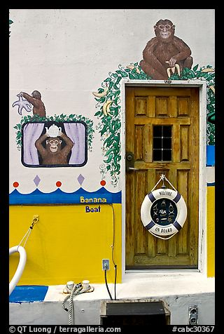 Door of houseboat decorated with a monkey theme. Victoria, British Columbia, Canada