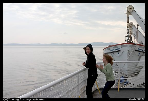 Woman and girl looking out from deck of ferry. Vancouver Island, British Columbia, Canada