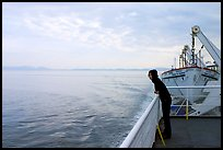 Woman looking out from deck of ferry. Vancouver Island, British Columbia, Canada (color)