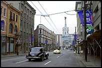 Street in Gastown with two old cars. Vancouver, British Columbia, Canada (color)