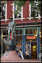 Statue and cafe in Gastown. Vancouver, British Columbia, Canada (color)