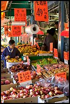 Fruit store in Chinatown. Some of the tropical fruit cannot be imported to the US. Vancouver, British Columbia, Canada (color)