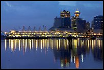 Canada Palace at night and Harbor Center at night. Vancouver, British Columbia, Canada