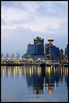 Canada Palace at night and Harbor Center at dawn. Vancouver, British Columbia, Canada
