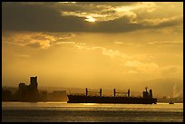 Cargo ship in harbor a sunrise. Vancouver, British Columbia, Canada