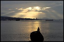 Girl in wetsuit statue, sunrise, Stanley Park. Vancouver, British Columbia, Canada