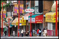 Street in Chinatown with red lamp posts and Chinese characters. Vancouver, British Columbia, Canada (color)