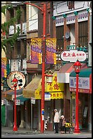 Street in Chinatown with red lamp posts and Chinese script. Vancouver, British Columbia, Canada