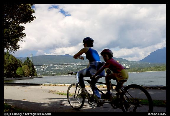 Tandem bicyclist on the trail around Stanley Park. Vancouver, British Columbia, Canada (color)