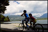 Tandem bicyclist on the trail around Stanley Park. Vancouver, British Columbia, Canada