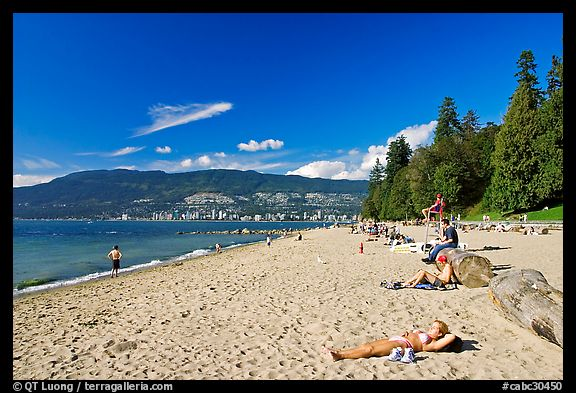 Woman sunning herself on a beach, Stanley Park. Vancouver, British Columbia, Canada (color)