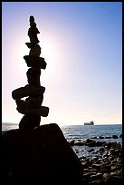 Backlit balanced rocks and ship in the distance. Vancouver, British Columbia, Canada