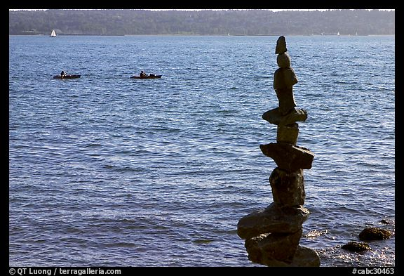 Balanced rocks and kayaks in a distance. Vancouver, British Columbia, Canada