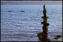 Balanced rocks and kayaks in a distance. Vancouver, British Columbia, Canada (color)