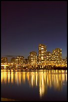 Skyline seen across False Creek at night. Vancouver, British Columbia, Canada