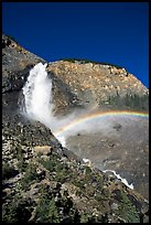 Rainbow formed in the mist of Takakkaw Falls. Yoho National Park, Canadian Rockies, British Columbia, Canada