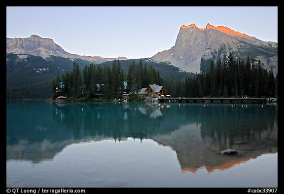 Cabins on the shore of Emerald Lake, with reflected mountains, sunset. Yoho National Park, Canadian Rockies, British Columbia, Canada