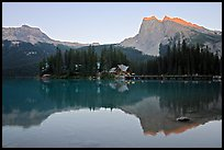 Cabins on the shore of Emerald Lake, with reflected mountains, sunset. Yoho National Park, Canadian Rockies, British Columbia, Canada (color)
