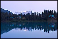 Trees and cabins reflected in Emerald Lake, dusk. Yoho National Park, Canadian Rockies, British Columbia, Canada