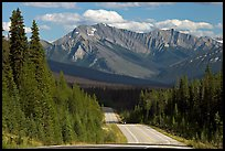Kootenay Parkway highway and mountains, afternoon. Kootenay National Park, Canadian Rockies, British Columbia, Canada