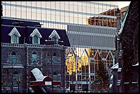 Reflection of an older building in the glass of a modern building, Montreal. Quebec, Canada (color)