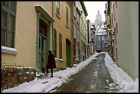 Narrow street partly covered with snow, Quebec City. Quebec, Canada