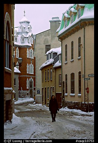 Man walking in a street in winter, Quebec City. Quebec, Canada