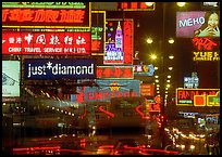 Nathan road, brilliantly lit by neon lights at night, Kowloon. Hong-Kong, China