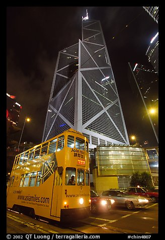 Old tram and Bank of China building (369m), designed by Pei, by night. Hong-Kong, China