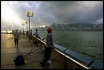 Fishing on the waterfront promenade, sunrise. Hong-Kong, China ( color)