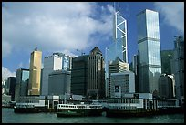 Star ferry leaves Hong-Kong island. Symmetrical shape alleviates need for turning around. Hong-Kong, China (color)